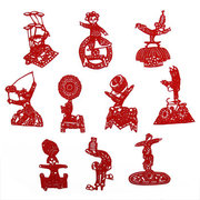 red handmade paper-cut of acrobatics